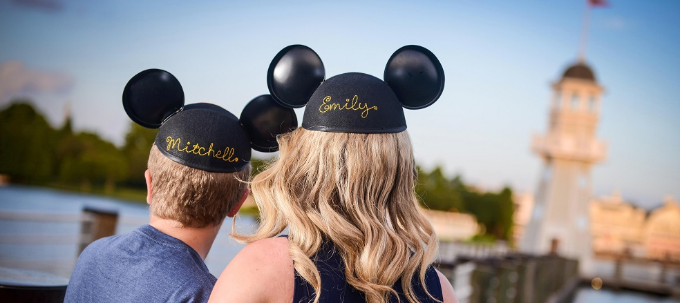 Picture of two kids from behind wearing Mickey Mouse Ears